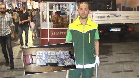 Zibil yığırdı, dollarla dolu pul qabı tapdı